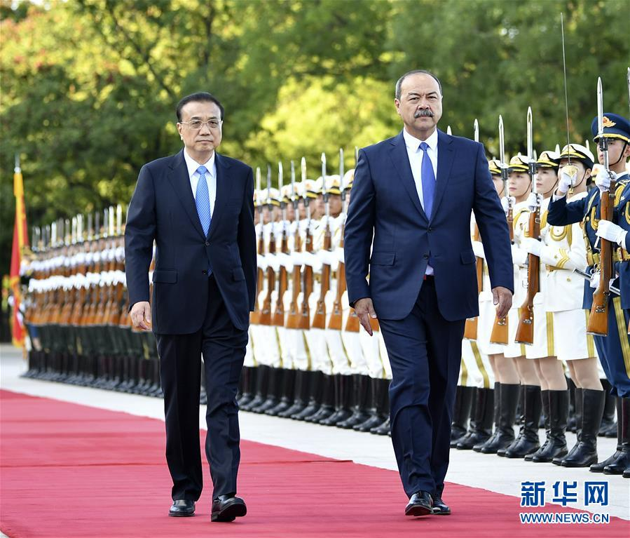 李克强同乌兹别克斯坦总理阿里波夫...
